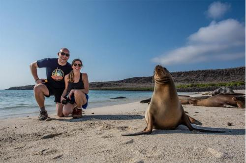 Guests with a sea lion at Sante Fe Island.